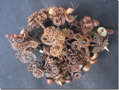 wreath human hair thumb 22 Most Bizarre Things Created Using Hair